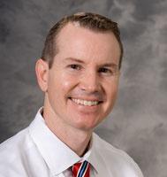 Mark E. Benson, MD